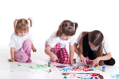 Three little cute sisters painting Royalty Free Stock Photo