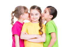Three little cute smiling girl gossip. Royalty Free Stock Images