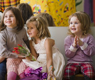 Three little diverse girls at birthday party Royalty Free Stock Image