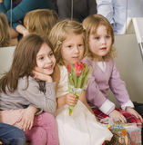 Three little diverse girls at birthday party having fun Stock Images
