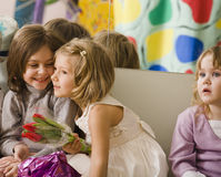 Three little diverse girls at birthday party having fun Stock Photography