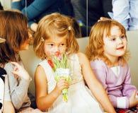 Three little diverse girls at birthday party having fun Stock Photos