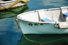 Three Little Fishes. Small row-boat with fishes stencilled on the side stock photos