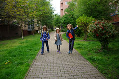Three little friends go to school. Stock Image