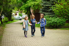 Three little friends go to school. Royalty Free Stock Image
