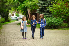Three little friends go to school. Royalty Free Stock Photography