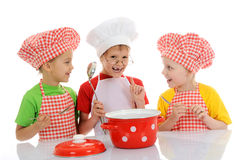 Three little funny chefs preparing soup Royalty Free Stock Photo