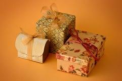 Three Little gift. Isolated on orange background Stock Photography