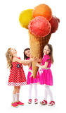 Three little girl and greatest ice cream stock images