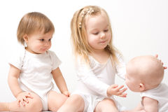 Three little girls. Three cute little girls - one, two and three years old Stock Photos