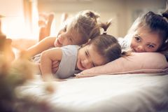 Three little girls in bed. royalty free stock photo
