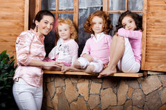 Three little girls, cute kids with mother Stock Images