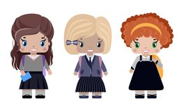 Three little girls in different school uniforms. And with backpacks smiling first graders Stock Images