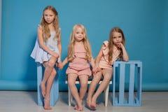 Three little girls girlfriend fashion portrait nice stock photos