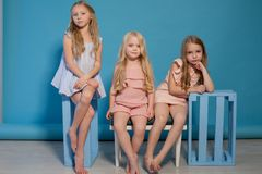 Three little girls girlfriend sit together portrait royalty free stock photo