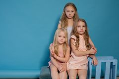 Three little girls girlfriend sit together portrait royalty free stock images