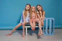 Three little girls girlfriend sit together portrait royalty free stock image