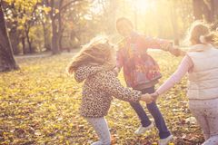 Smiling little girls in park. stock photography