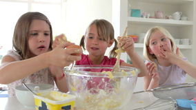 Three Little Girls Making Cake Together Royalty Free Stock Photography