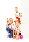 Three little girls in painted shirts smile Royalty Free Stock Photography
