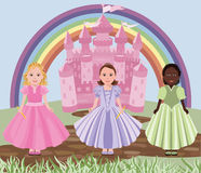 Three little girls or princesses and fairy tale castle Stock Images