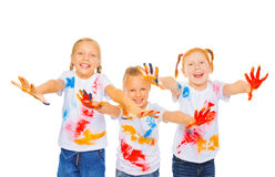 Three little girls show palms and smile Royalty Free Stock Photos