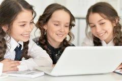 Three little girls using a laptop Stock Photos