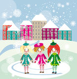 Three little girls walking in winter city square Stock Image