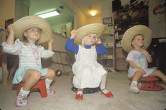 Three little girls wearing sombreros at their daycare center, Washington D.C. Royalty Free Stock Image