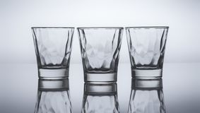 Three little glass for drink. Still life shoot of three  little glass in a cold gray  background Stock Photography