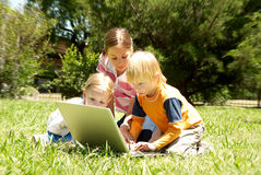 Three Little Hackers In The Park Royalty Free Stock Images