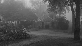 The three little huts in the fog. The three huts in the middle of the nature with the fog surrounding. Also in black and white Stock Image