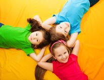 Kids laying on the floor Royalty Free Stock Photography