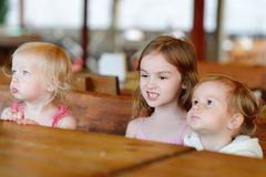 Three little kids in an outdoor cafe. Three little kids in an outdoor restaurant stock photos