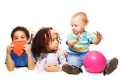 Three little kids playing Stock Photo