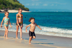 Three little kids playing at the beach Royalty Free Stock Photos