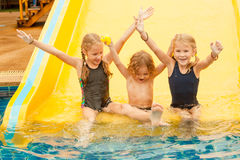Three little kids playing in the swimming pool Royalty Free Stock Photography