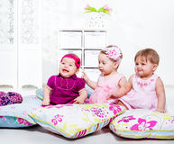 Kids among pillows Stock Image