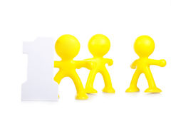Three little men and figure 1 Stock Images