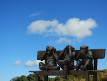 Three little monkeys sculpture