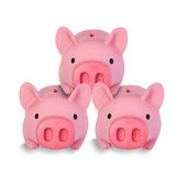 Three little pig coin banks stacked on each other Stock Photos