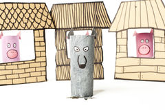 The Three little pigs kids story. Cardboard made 3 little pigs story.Pigs and wolf. Straw, atrcks and bricks houses Royalty Free Stock Photography