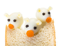 Three Little Pigs from quail eggs. And a slice of bread Stock Photo