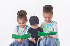 Three little readers stock images