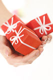 Three little red surprises in woman hand Stock Photos