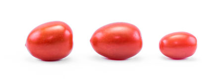 Three little red tomatoes on a white background Stock Image
