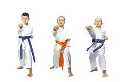 Three little sportsmen beats blow gyaku-tsuki. Little sportsmen beats blow gyaku-tsuki Royalty Free Stock Photo