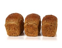Three loaves of bread with eight cereals Royalty Free Stock Photos