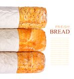 Three loaves of fresh wheat on white background Royalty Free Stock Photos