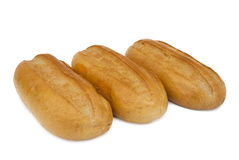 Three loaves of white bread. On a white background Stock Photo